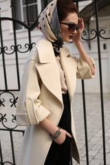 beautiful woman in elegant coat and silk scarf on head