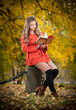 Beautiful elegant girl with orange coat reading reading