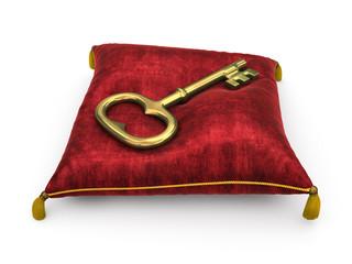 Golden key on royal red velvet pillow isolated on white backgrou