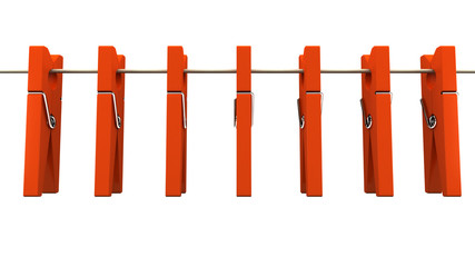 Red wooden clothespins on rope