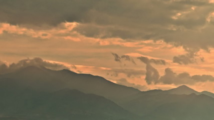 Retezat mountain tops clouds at sunset time lapse