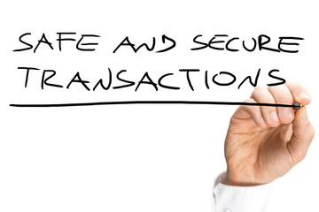 Male hand writing Safe and secure transactions