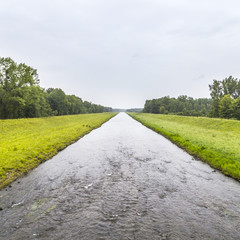 canal in Elsass in rain
