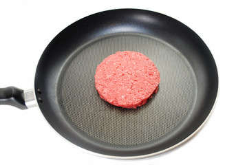 Raw Lean Hamburger in a Frying Pan on White