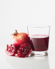 Pomegranate and glass of pomegranate juice