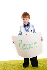 little boy standing with the inscription peace