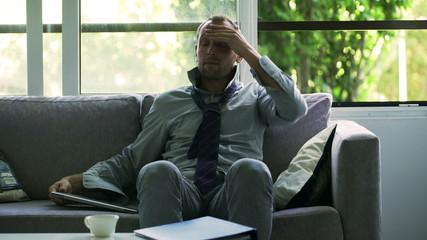 Businessman finish working on laptop and drinking coffee