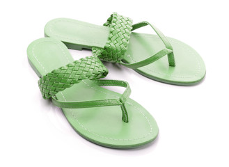 Green flip flops on a white backgrond