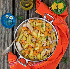 Potatoes skillet with pumpkin and herbs