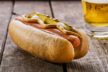 hot dog with mustard, pickles and onions