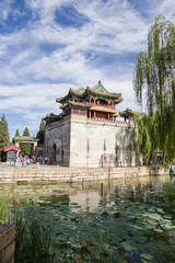 Beijing, Summer Palace. Tower with a pagoda on the lake.