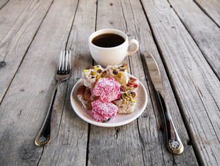 Turkish Delight, a cup of coffee with a fork and knife