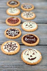 Tasty Halloween cookies on wooden table