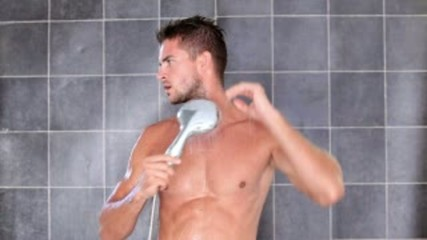 young sexy man having a shower