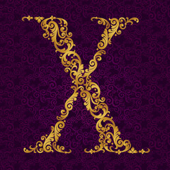 Gold font type letter X, uppercase.