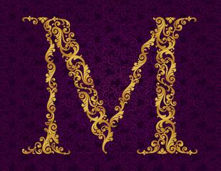 Gold font type letter M, uppercase.