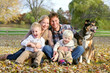 Happy Family and Pet Dog Autumn Portrait - 72111115
