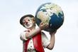 canvas print picture - Clown mit Erde