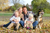 Happy Family and Pet Dog Autumn Portrait poster