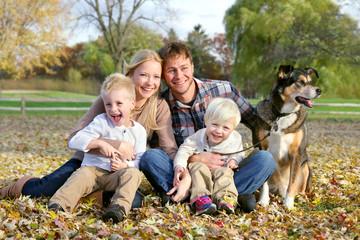 Happy Family and Pet Dog Autumn Portrait