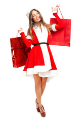 Woman wearing Santa Claus costume with shopping bags