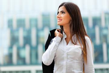 Portrait of a confident businesswoman walking in a city