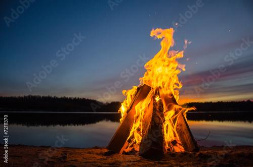 Fotobehang Vuur / Vlam Bonfire on the beach sand