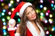 Santa Claus woman throwing a snowball