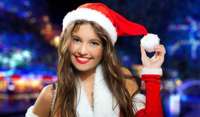 Santa Claus woman holding a snowball