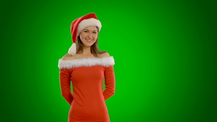 Young beautiful girl standing  in a cap of Santa Claus