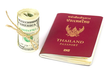 Thailand passport and roll of dollars money on white background