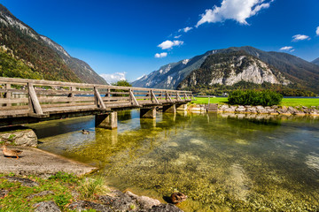 Wooden bridge over the river between by mountains