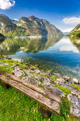 Old bench at mountain lake in the Alps
