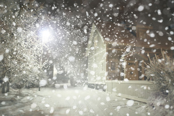 Winter night  street in city, snowfall.