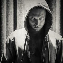 Sporty man in hood, monochrome portrait