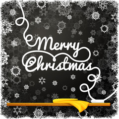 Merry christmas message, written on the black school chalkboard