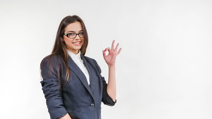 Young business woman showing OK gesture
