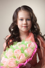 Lovely young girl with bouquet of paper tulips