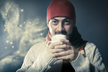 Man holding a cup