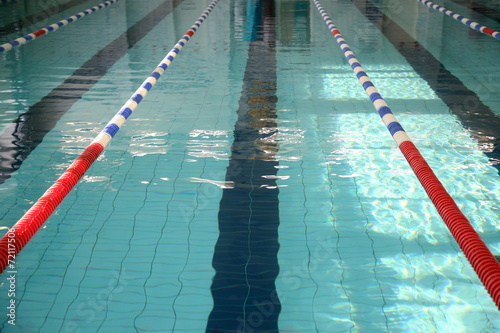 Fototapeta The swimming pool with blue water