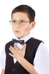 Young boy with kiss trace on his cheek