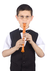 Young boy playing the flute