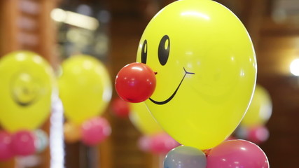 Helium-filled balloons to children's birthday party