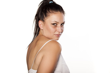 young woman with poor makeup posing on a white background