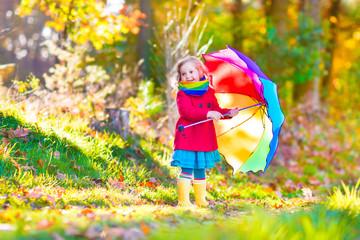 Little girl in an autumn park