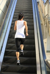 Runner athlete running on escalator stairs.