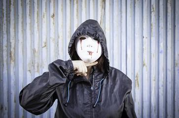 Masked woman threatening