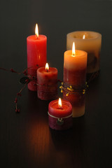 romantic candles on dark wooden table