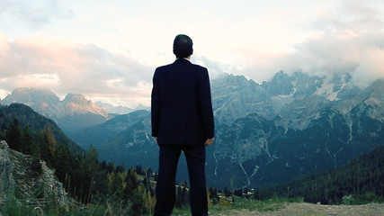 Man feeling freedom in the mountains