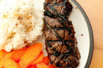 grilled beef tenderloin steak with mashed potatoes